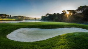 PGA Catalunya 3rd hole with hole 11 across the lake